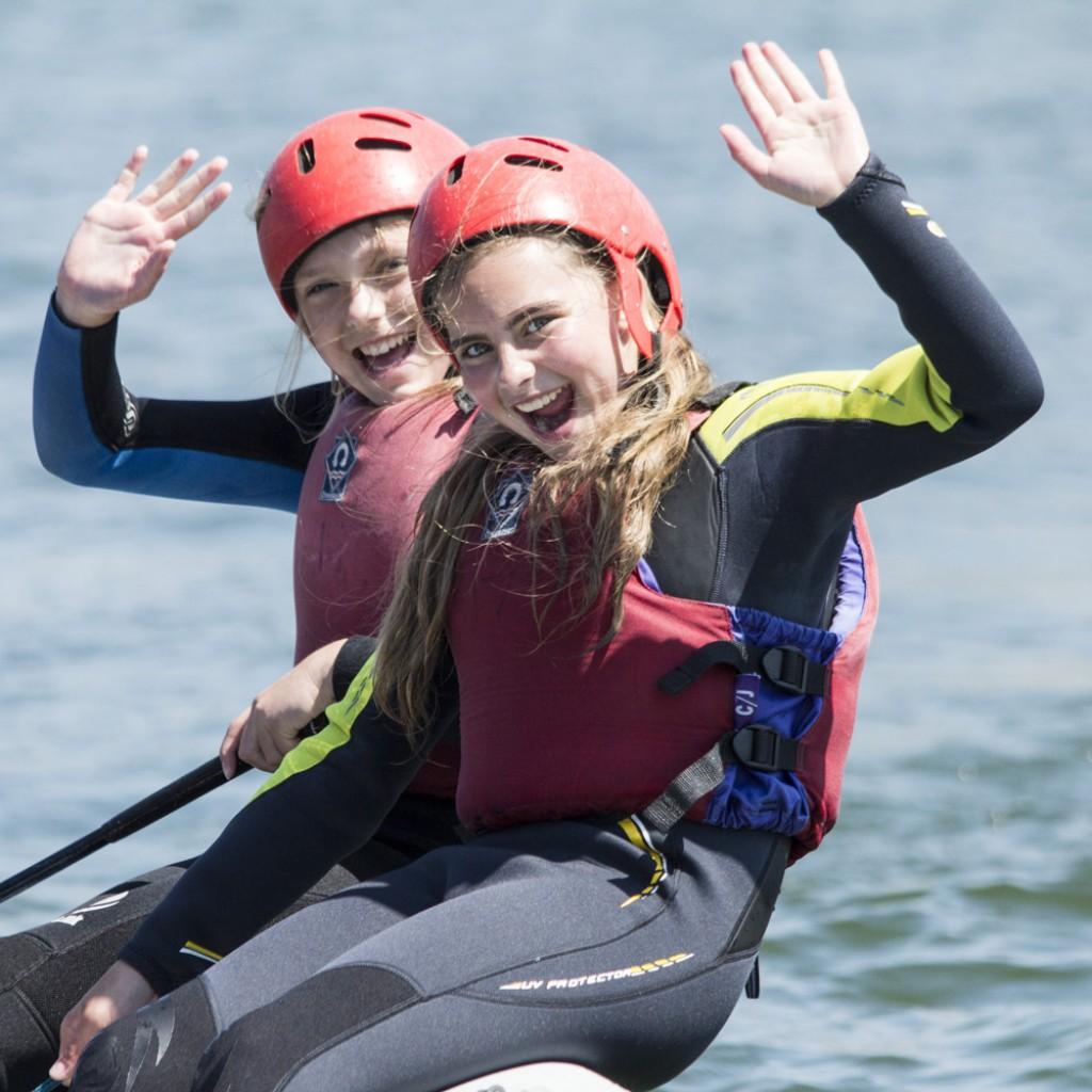 kids watersports activities sailing waving
