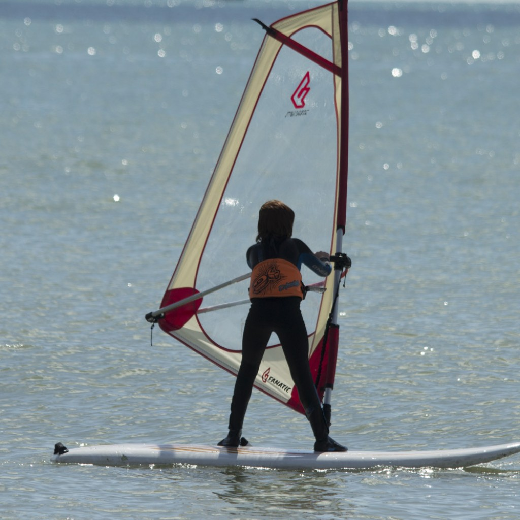 kids watersports activities windsurfing youngster on sea