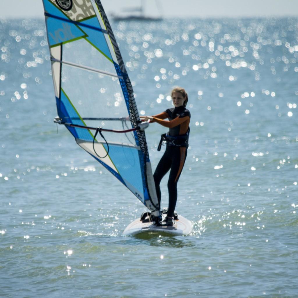 kids watersports activities windsurfing girl on sea