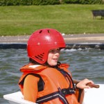 kids watersports activities sailing steering